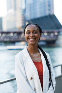 A photo of Jessica Daniels in front of the Chicago River